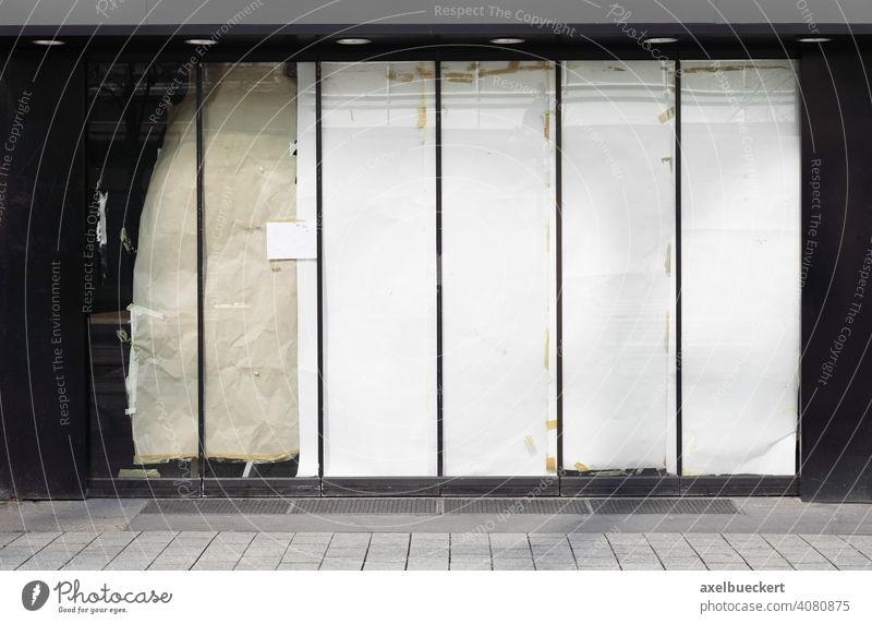 closed or empty shop or store storefront with blocked windows business vacancy closure economy crisis abandoned property lockdown shutdown bankruptcy shopfront