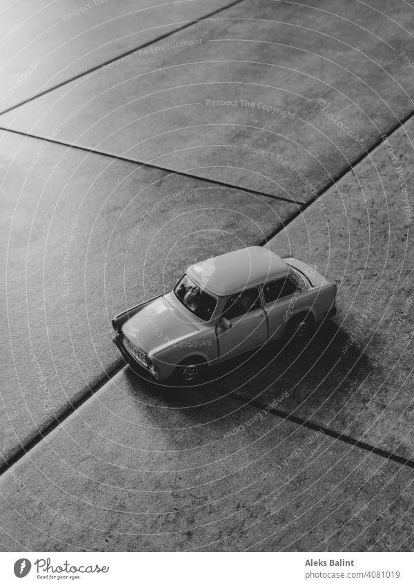 Toy car on tiles Toys Infancy trobant Trabbi Black & white photo Car GDR Playing Vehicle