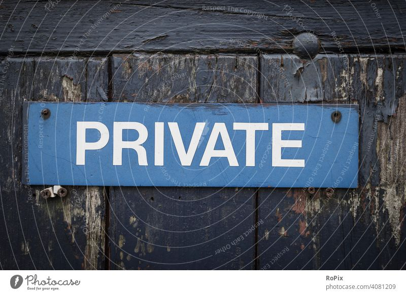 Sign on a weathered garden gate. private info Communication Private message sign board door Wall (barrier) writing authorized unauthorized Blue blue boards