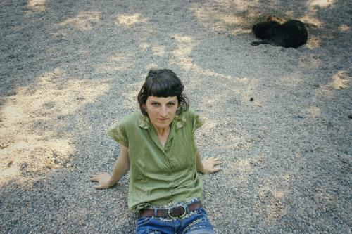 Woman sitting on gravel floor Easygoing Gravel Meditative Identity Reflected Serene Feminine Break Earth Sit critical being out Loneliness Playground Beach