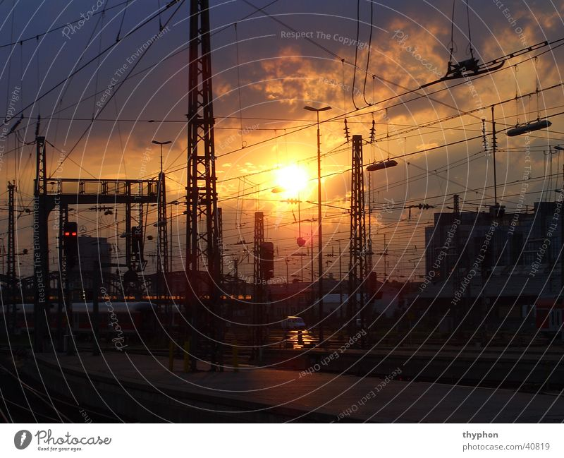 Sunset at the station Overhead line Wire Railroad tracks Munich Transport Train station Scaffold