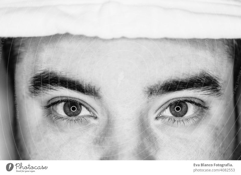 close up view of the eyes of a young man. black and white. led ring reflection in the eyes head people male dramatic person lifestyle closeup shot one lonely