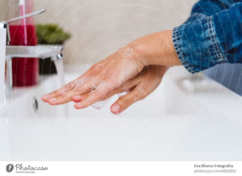 unrecognizable woman washing hands on a sink with soap. Coronavirus covid-19 concept corona virus stay home alcohol hygiene personal sanitary life water female