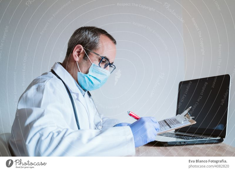 doctor man working on laptop. Corona virus test on table. Covid-19 concept corona virus covid-19 protective gloves protective mask technology analysis vaccine