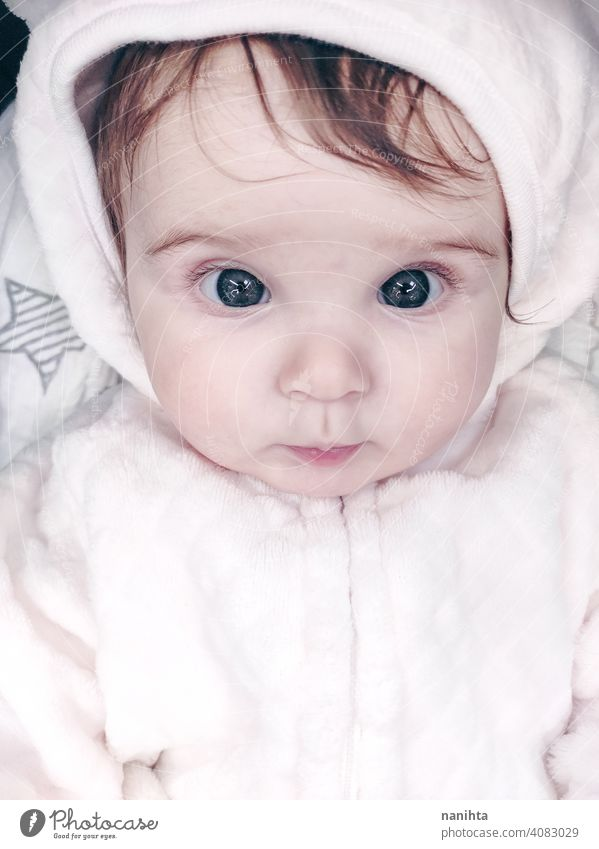 Lovely portrait of a baby girl wearing winter clothes infancy cute little face eyes gray eyes newborn parenthood child cutie lovely adorable cozy pose