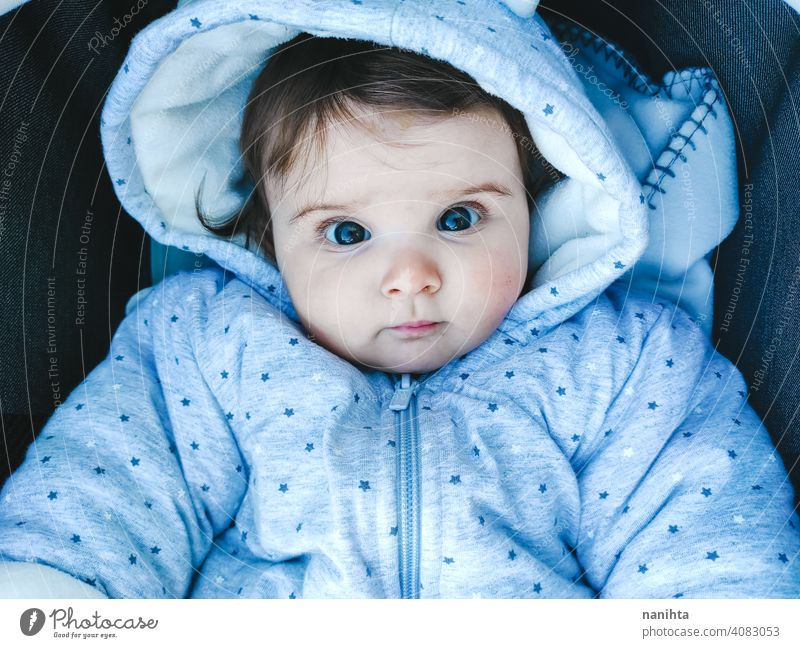 Lovely portrait of a 8 months baby girl cute lovely newborn life warm cozy hood hoodie childhood family kid parenting family time fun funny adorable innocence