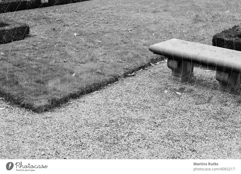 Garden of arts. Jardin des Arts - Albert Schweitzer. Paris. park bench lines grass gravel sand straight overcast Lanes & trails Park bench Black & white photo