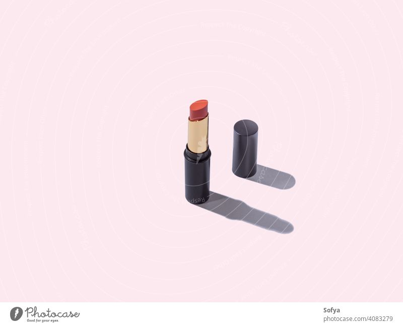 Open red nude lipstick make up package on pink background geometry makeup product cosmetic tube white beauty orange diagonal geometrical open women isolated