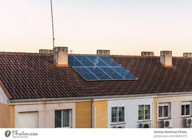 House with Photovoltaic Panels on the Roof Getting Energy from the Sunlight solar panel sun energy power house rooftop residential fuel environment choice