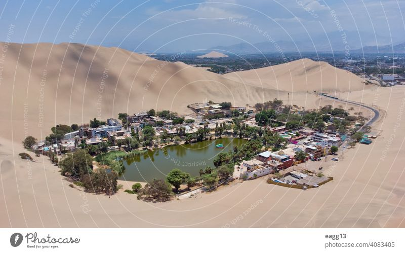 View of the Huacachina oasis in Ica, Peru abstract awe calmness desert destination dream dune ecosystem explore extreme famous famous place huacachina ica
