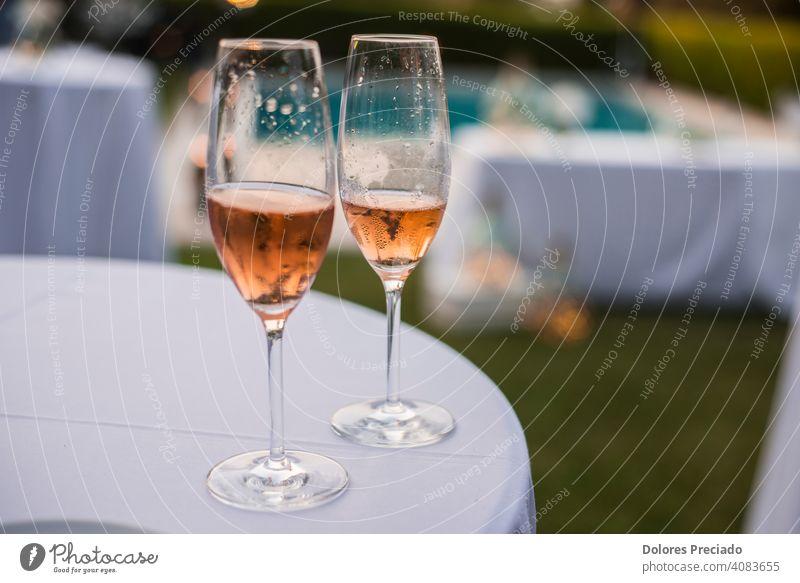 Two half glasses of rose wine drink alcohol winery luxury party liquor romantic beverage cabernet wineglass refreshing celebrate pour celebration merlot