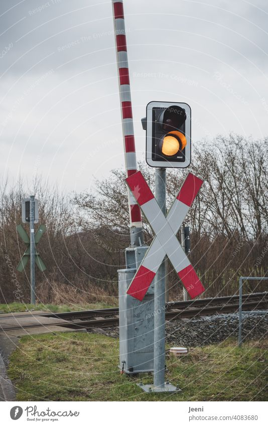 Even if the signal colour indicates yellow, you have to wait at the railway tracks railway barrier Control barrier Above Railroad crossing Track