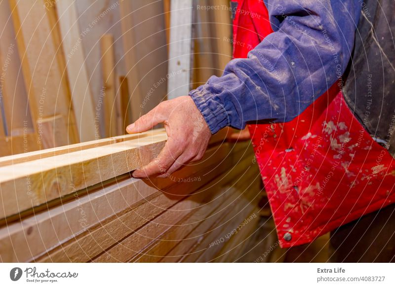 Carpenter lines up the glued wooden profiles in carpentry, preparing them for clamping Adhesive Align Apply Arrange Board Carpentry Collection Concept