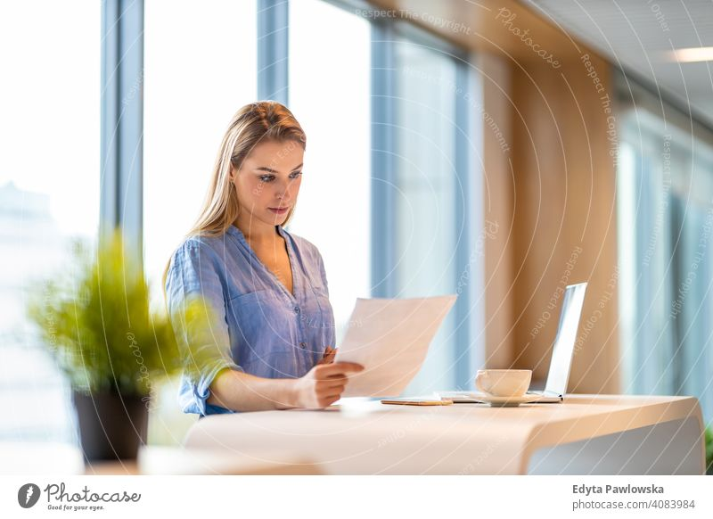 Portrait of confident businesswoman in office girl people Entrepreneur successful professional young adult female lifestyle indoors millennial attractive