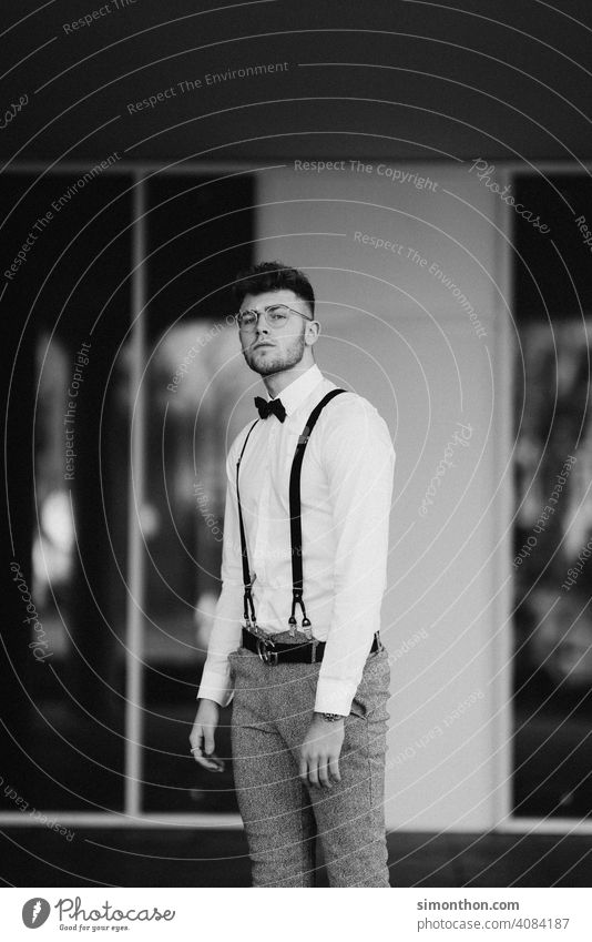 model Clock Exterior shot Modern pretty Hair and hairstyles Style Suspenders Shirt Cool (slang) Guy Looking successful gentleman Black and white photography