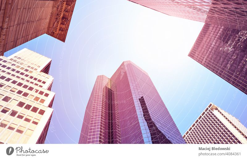Looking up at Manhattan skyscrapers, color toned picture, New York City, USA. city office building business pink purple blue look up NYC wall filtered