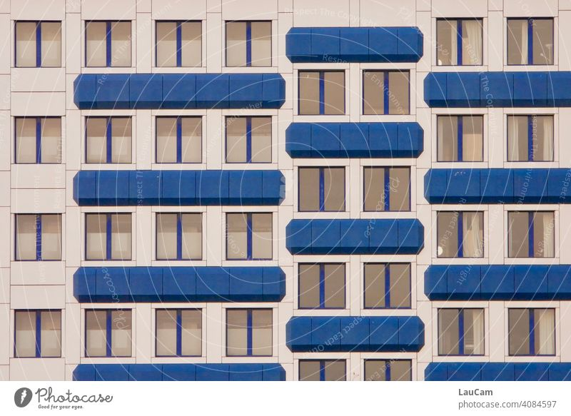 Blue and white facade of a hotel with many windows in Prenzlauer Berg Window Facade Cladding Building Hotel Hotel room White blue-white Exterior shot