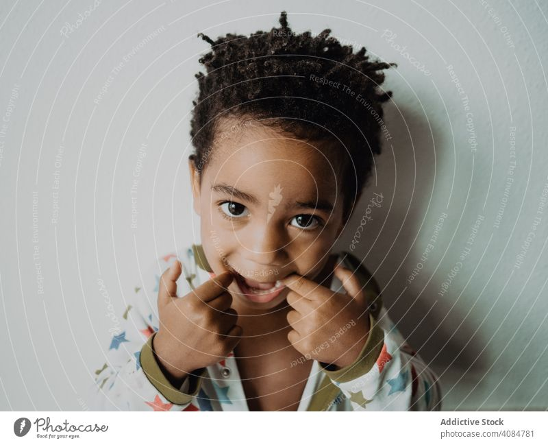 Black child grimacing for camera boy grimace funny african american pajamas face expression little joy kid cheerful happy cute adorable sweet lovely charming