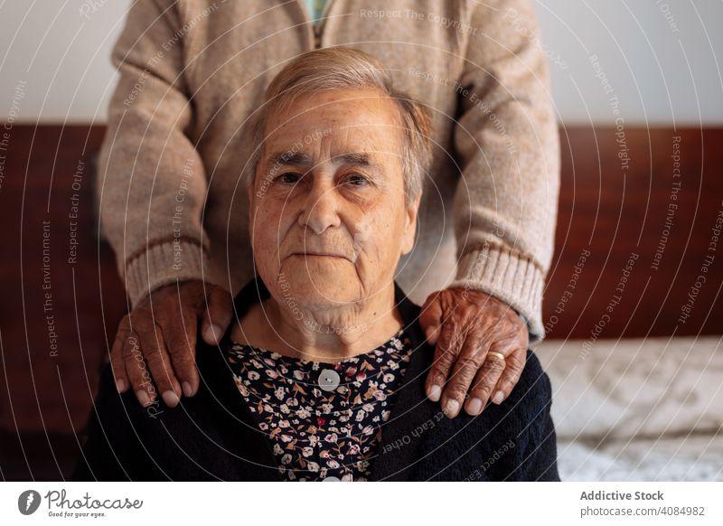 Elderly couple in interior of their house elderly senior old portrait sad mature family female caucasian aged retirement alzheimer people woman lifestyle