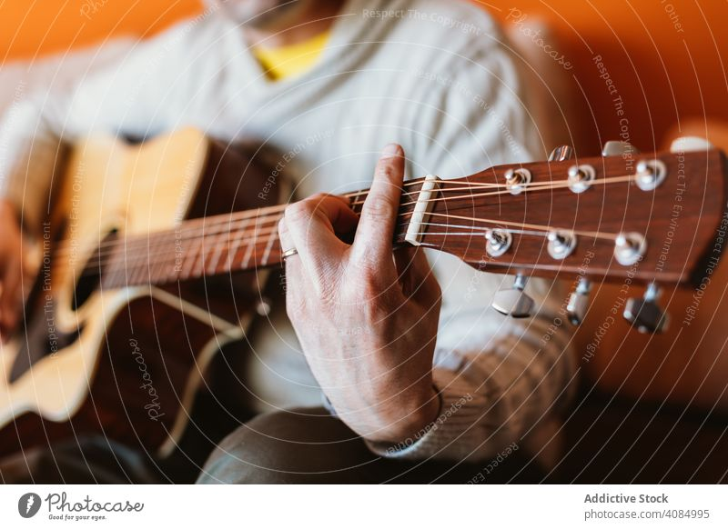 Detail of a man playing the guitar musician acoustic closeup instrument old detail hand player musical string concert chord classic guitarist electric finger