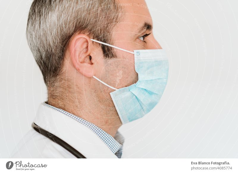 portrait of doctor wearing protective mask and gloves indoors. Corona virus concept man professional corona virus hospital working infection safety epidemic