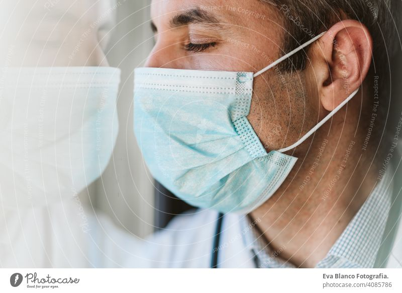 doctor man wearing protective mask and gloves indoors. Corona virus concept portrait professional corona virus hospital working infection safety epidemic