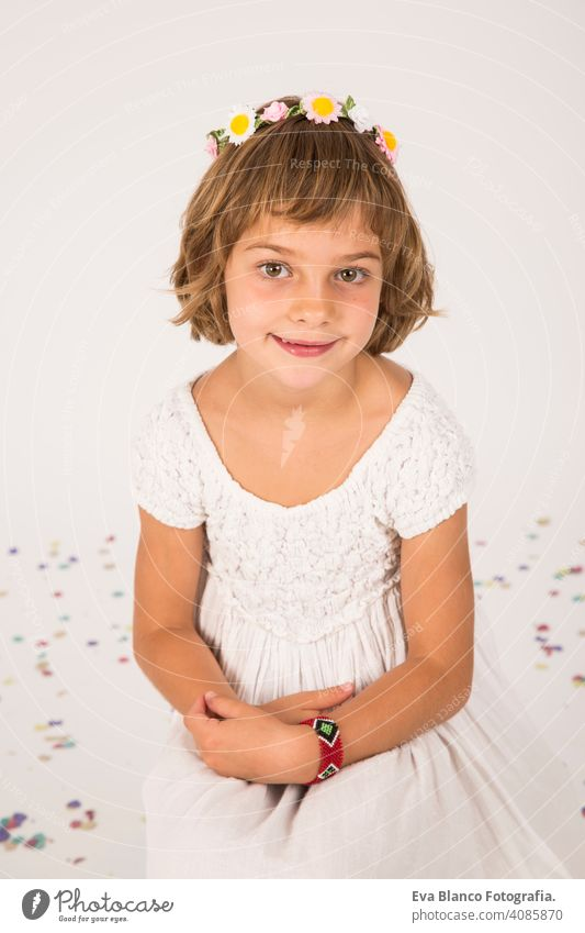 little girl portrait. indoors, confetti on the floor. white  background fun child cute lifestyle happiness cheerful kid beautiful hair face childhood caucasian