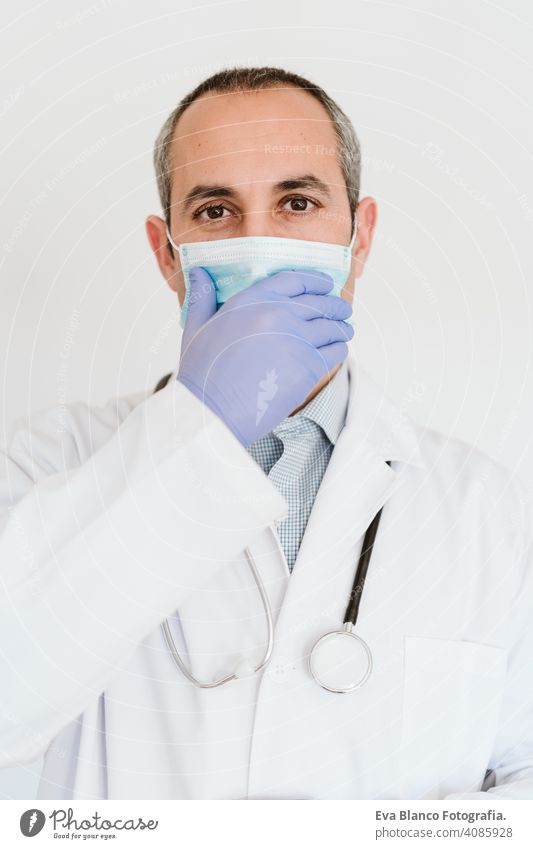 portrait of caucasian doctor using protective gloves and mask. Chinese Corona virus concept. 2019-nCoV stop hand man professional corona virus hospital working