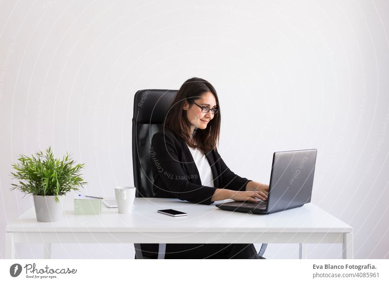 beautiful young Business woman using his laptop  in the office. Business Concept.white backgrounds computer worker businesswoman mobile smart phone tablet plant