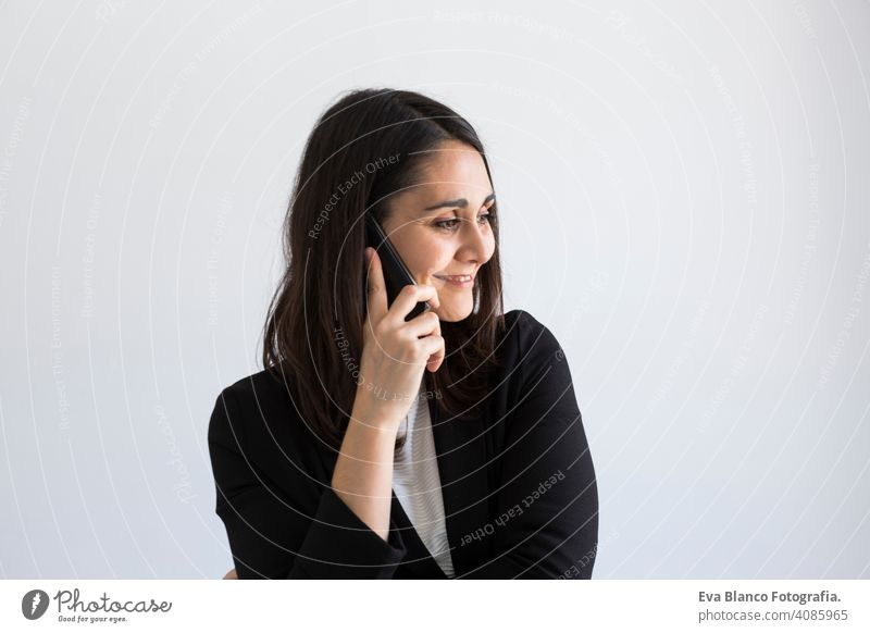 beautiful young business woman talking on her mobile phone and smiling. white background. business concept. Lifestyles computer office laptop worker