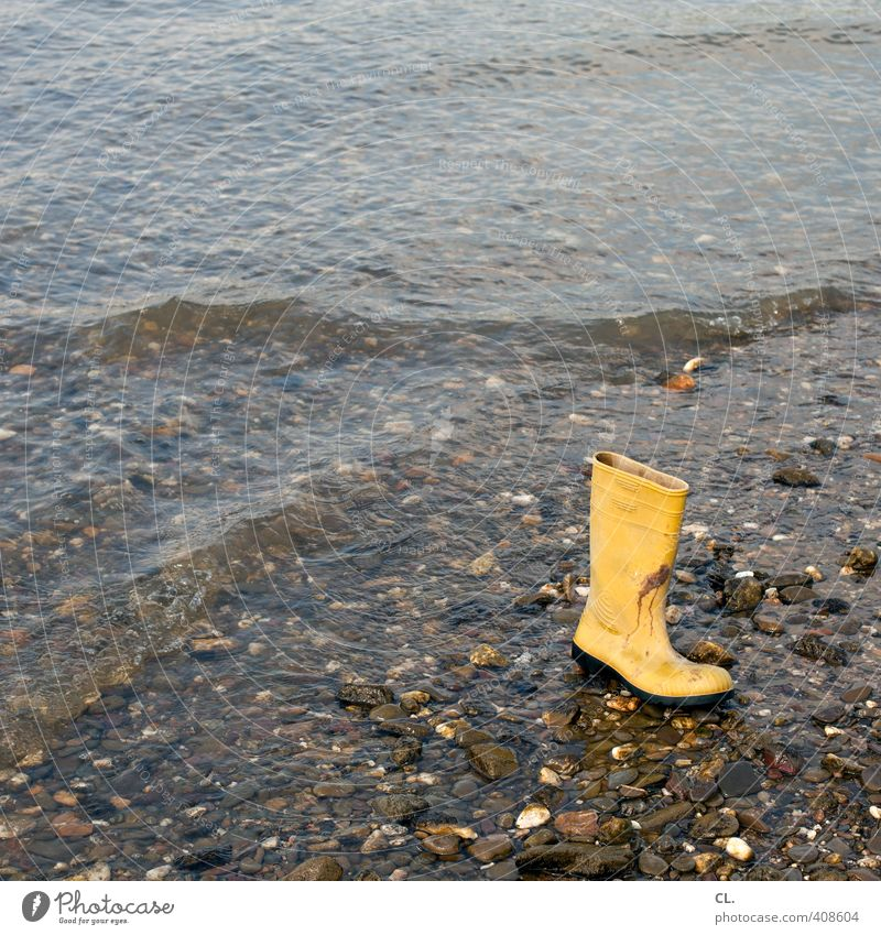 flotsam and jetsam Nature Earth Water Waves Coast River bank Beach Rhine Clothing Footwear Boots Rubber boots Yellow Mysterious Whimsical Stone Doomed