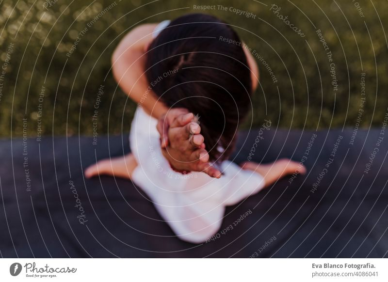 young beautiful asian woman doing yoga in a park at sunset. Yoga and healthy lifestyle concept. Top view. Selective focus summer happy enjoyment sport sportive