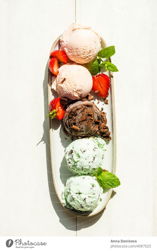 Selection of different ice cream scoops such as mint, chocolate and strawberry mint choc chip vanilla popsicle lollies food dessert frozen white delicious fresh