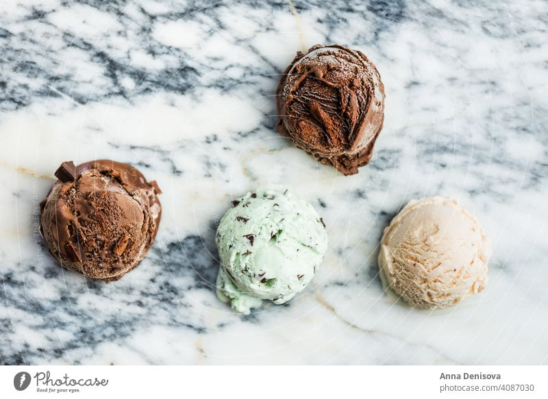 Selection of different ice cream scoops strawberry chocolate mint choc chip vanilla popsicle lollies food dessert frozen white delicious fresh sweet cold