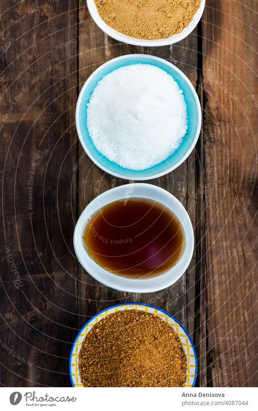 Different Kinds of Sugar and Sweeteners in the Bowls sugar demerara maple syrup honey coconut agave icing caster granulated golden cane dessert brown heap grain