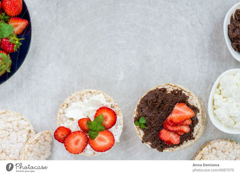 Healthy Snack from Rice Cakes with Hazelnut Spread, Ricotta Chee rice cakes cream snack cheese view food top healthy hazelnut chocolate breakfast fresh red