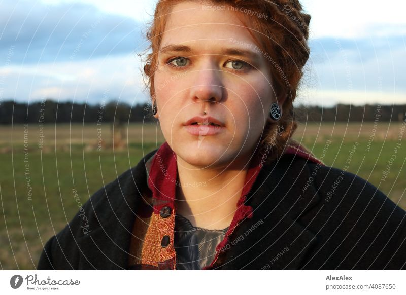 Young woman with dreadlocks in the evening sun on a pasture Woman Dreadlocks Identity naturally portrait Red-haired Esthetic Adults Youth (Young adults)