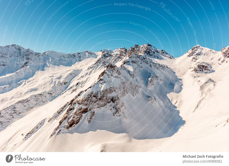 Wonderful view of the snow-capped Swiss Alps and blue sky from the Pizol mountain panorama pizol mountains alps lake switzerland swiss hiking swiss mountains