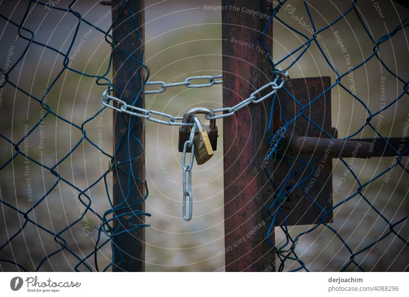 No way through.  Two old rusty lattice gates, are locked by a new padlock with chain, respectively secured. Safety Old Exterior shot Closed Colour photo Metal