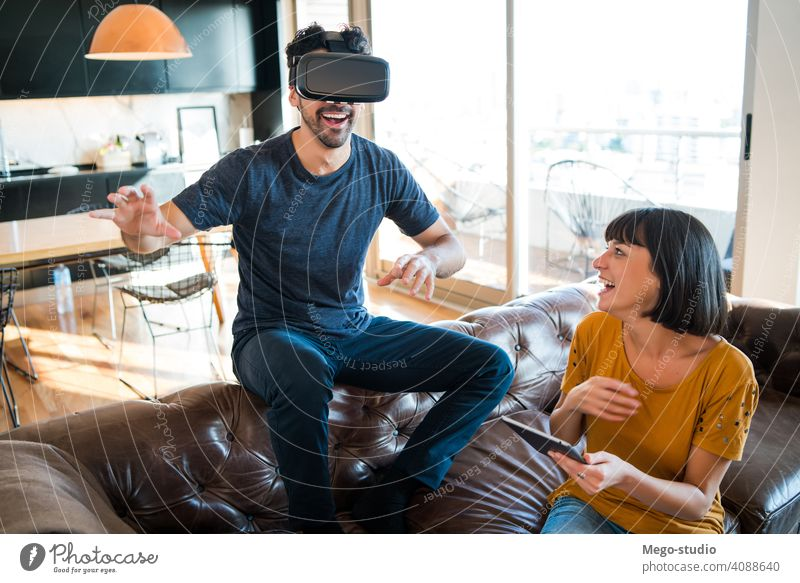 Couple playing video games with VR glasses. couple reality vr digital tablet gaming goggles simulation device entertainment indoors young headset virtual woman
