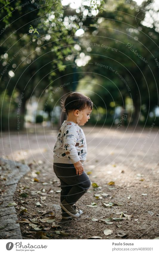 Child walking in the park childhood side view Park Authentic Childhood memory Multicoloured Day 1 - 3 years Joy Caucasian Infancy Exterior shot Colour photo