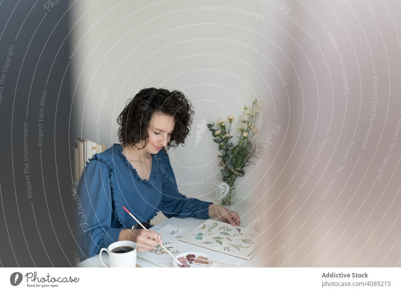 Woman painter working at home woman drawing picture flower hand art artist workplace creativity design craft leisure artwork professional inspiration talent