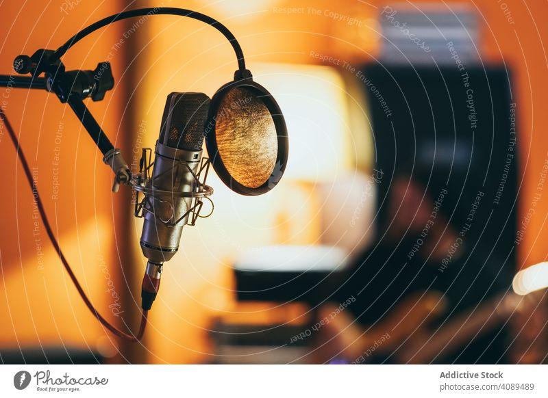 Professional studio microphone recording silver pop isolated sound jockey industry communication radio singing karaoke professional cable using shield