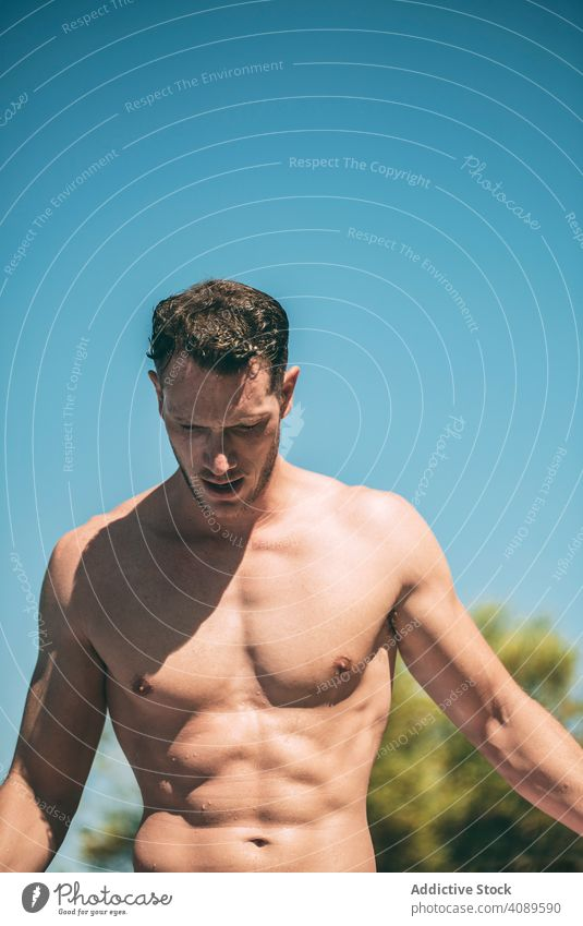 Handsome muscular man in sunny day shirtless wet hair male athletic young body person lifestyle handsome sport fit summer healthy fitness guy attractive