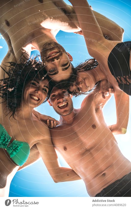 Friends hugging posing for photo friends summer vacation fun leisure happiness bikini laughing together party cheerful friendship holidays sun joyful resort