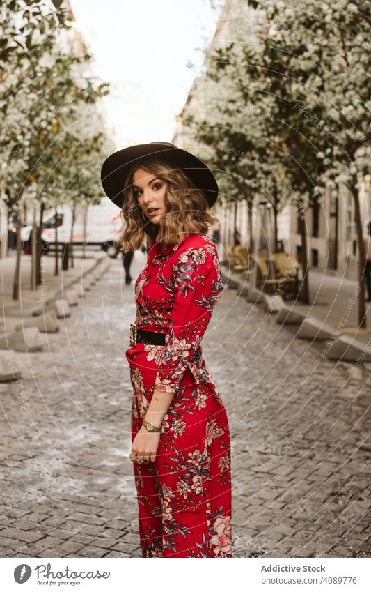 Trendy lady walking on old pavement woman stylish sensual city street path young female outfit hat dress way aged ancient pedestrian trendy elegant lifestyle