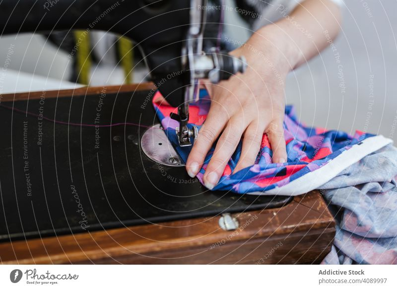 Teenage girl in a sewing school woman class classroom teenager clothing embroidery fabric factory job machine pattern profession seamstress student studio