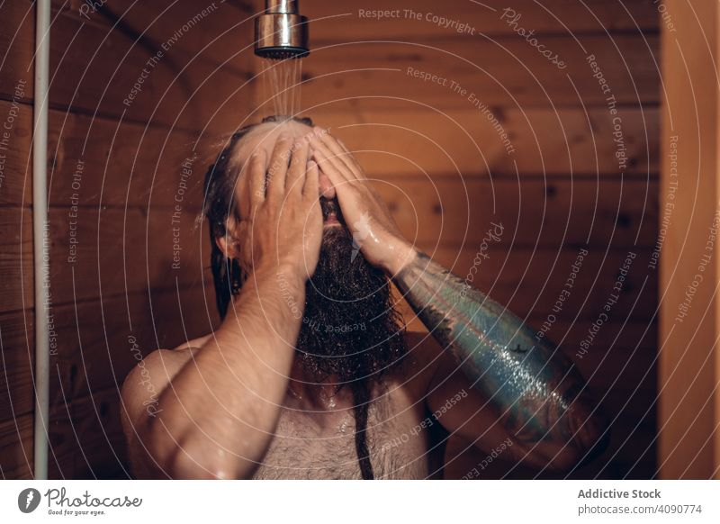 Man taking shower in wooden bathroom man water male wet clean care hygiene healthy hipster person handsome morning fresh bearded washing hair showering nude