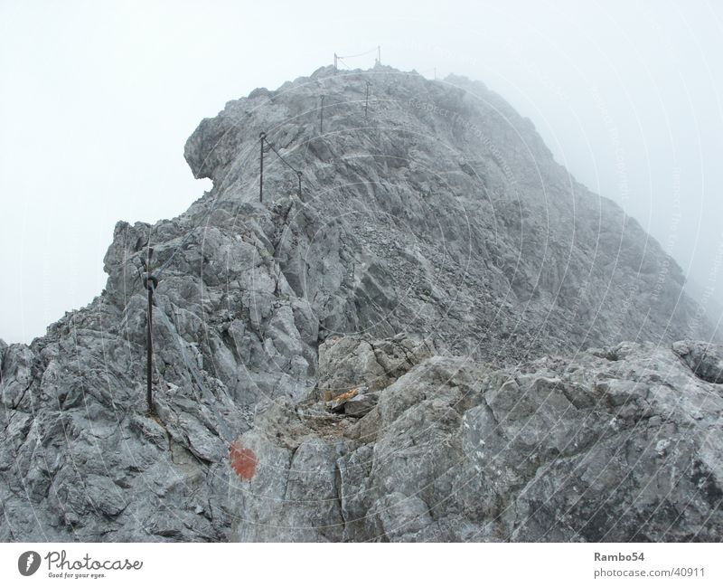 The way Mountain Heilbronner Weg near Oberstdorf approx. 2400m height 7 degrees Fog gusty wind up to 40 Km/h