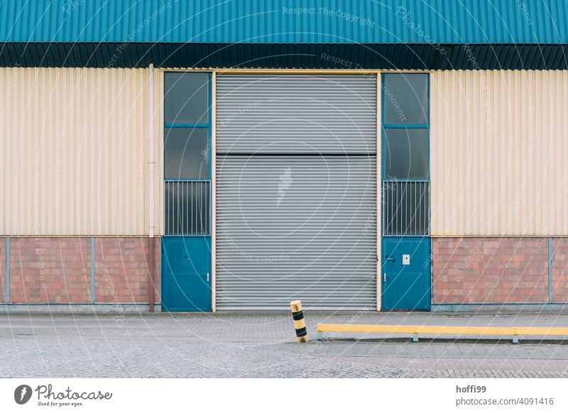dreary view of a warehouse with approached boundary pile Warehouse Harbour Storage Facade Depot Wall (building) Industrial plant Factory Architecture Trade